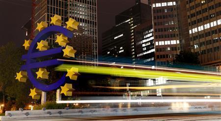 A tram runs past the euro sign landmark outside the headquarters of the European Central Bank (ECB) in Frankfurt September 2, 2013. REUTERS/Kai Pfaffenbach