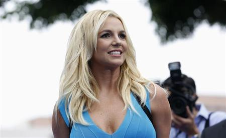 Singer Britney Spears poses at the premiere of ''The Smurfs 2'' at the Regency Village theatre in Los Angeles, California July 28, 2013. REUTERS/Mario Anzuoni
