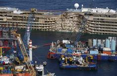 """The capsized cruise liner Costa Concordia is seen at the end of the """"parbuckling"""" operation outside Giglio harbour September 17, 2013. REUTERS/Tony Gentile"""