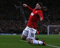 Wayne Rooney celebra gol do Manchester United sobre o Bayer Leverkusen. REUTERS/Phil Nobl