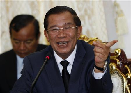 Cambodian Prime Minister Hun Sen smiles during a meeting with Sam Rainsy, president of the Cambodia National Rescue Party (CNRP), at Cambodia's National assembly in central Phnom Penh September 17, 2013. REUTERS/Samrang Pring
