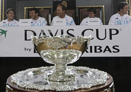 Argentina's team members sit behind the Davis Cup as they attend the draw for the Davis Cup semifinals in Prague September 12, 2013. REUTERS/David W Cerny