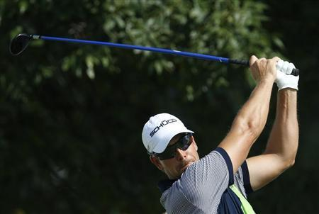 Henrik Stenson of Sweden hits from the 10th tee during the first round of the BMW Championship golf tournament at the Conway Farms Golf Club in Lake Forest, Illinois, September 12, 2013. REUTERS/Jim Young