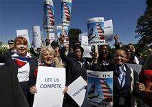 US Airways flight attendants chant during a protest by pilots, flight attendants, baggage handlers and other union members working for American Airlines and US Airways urging the U.S. Justice Department to allow the two companies to merge at a rally in front of the U.S. Capitol building in Washington September 18, 2013. REUTERS/Jim Bourg