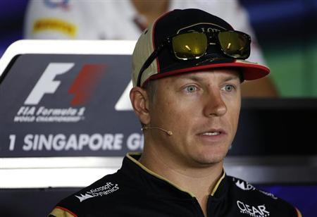 Lotus Formula One driver Kimi Raikkonen of Finland speaks during a news conference ahead of the Singapore F1 Grand Prix September 19, 2013. The Singapore F1 night race will take place on September 22, 2013. REUTERS/Edgar Su