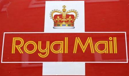 Rain drops fall on a Royal Mail van outside it's Bethnal Green sorting office in east London, September 12, 2013. REUTERS/Paul Hackett