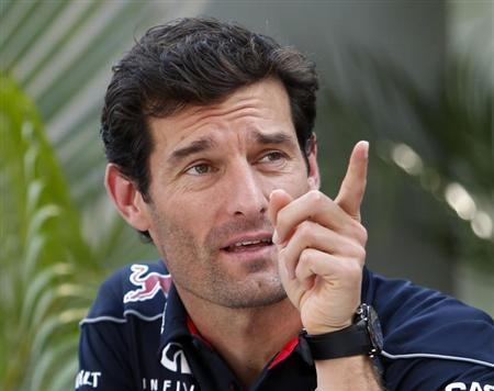 Red Bull Formula One driver Mark Webber of Australia gestures while sitting in the team hospitability area ahead of the first practice session of the Singapore F1 Grand Prix at the Marina Bay street circuit in Singapore September 20, 2013. REUTERS/Tim Chong