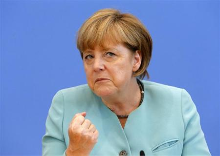 German Chancellor Angela Merkel gestures as she address media during a news conference at Bundespressekonferenz in Berlin July 19, 2013. REUTERS/Tobias Schwarz