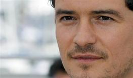 "Cast member Orlando Bloom poses during a photocall for the film ""Zulu"" at the 66th Cannes Film Festival in Cannes May 26, 2013. REUTERS/Regis Duvignau"