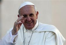 Pope Francis waves as he arrives to lead his Wednesday general audience in Saint Peter's Square at the Vatican in this September 18, 2013 file photo. REUTERS/Stefano Rellandini/Files