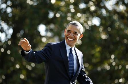 U.S. President Barack Obama smiles and waves as he departs the White House in Washington September 20, 2013. Obama is on a day trip to Kansas City, Missouri. REUTERS/Kevin Lamarque