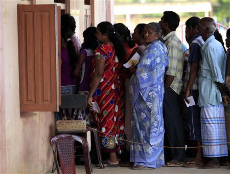 Ethnic Tamils wait in line to cast their votes at a polling station during the first provincial polls in 25 years in Jaffna, a former war zone in northern Sri Lanka about 400 kilometres (249 miles) north of Colombo, September 21,2013. REUTERS-Dinuka Liyanawatte