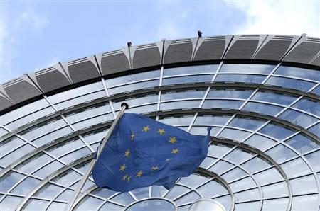 An European Union flag flutters outside of the European Parliament in Brussels October 12, 2012. REUTERS/Francois Lenoir