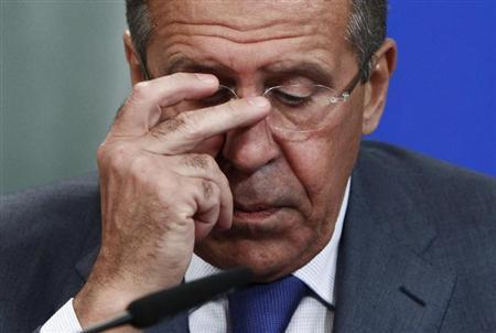 Russia's Foreign Minister Sergei Lavrov adjusts his glasses during a news conference after a meeting with his French counterpart Laurent Fabius in Moscow, September 17, 2013. REUTERS/Maxim Shemetov