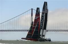 Emirates Team New Zealand (back) and Oracle Team USA sail to the starting line during the 34th America's Cup yacht sailing race in San Francisco, California September 22, 2013. REUTERS/Robert Galbraith (UNITED STATES - Tags: SPORT YACHTING)
