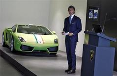 Stephan Winkelmann, CEO of Lamborghini, speaks with the media next to a Lamborghini Gallardo LP 550 during an opening ceremony of a new dealership, in New Delhi September 23, 2013. REUTERS/Anindito Mukherjee