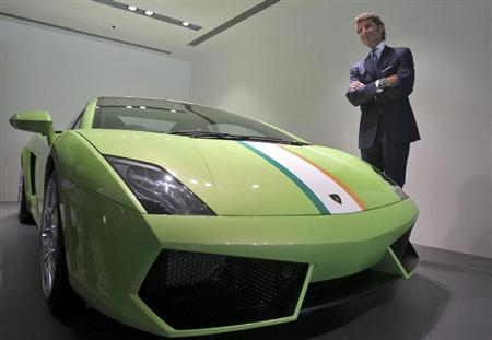 Stephan Winkelmann, CEO of Lamborghini, poses next to a Lamborghini Gallardo LP 550 during an opening ceremony of a new dealership, in New Delhi September 23, 2013. REUTERS/Anindito Mukherjee