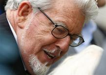 Entertainer Rolf Harris arrives at Westminster Magistrates Court, to face sex offence charges, in central London September 23, 2013. REUTERS/Andrew Winning