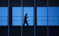 A student uses his mobile phone as he walks inside the Engineering building at the University of Waterloo, located beside the Blackberry maker's Research in Motion (RIM) headquarters in Waterloo April 18, 2012. Picture taken April 18, 2012. REUTERS/Mark Blinch