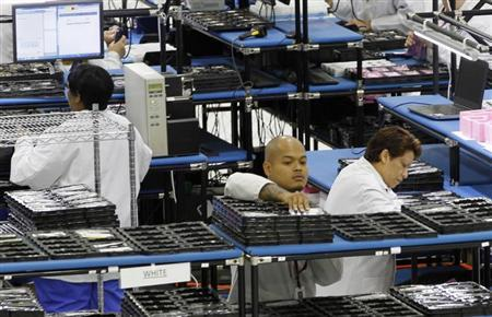 Workers assemble Motorola phones at the Flextronics plant that will be building the new Motorola smart phone ''MotoX'' in Fort Worth, Texas September 10, 2013. REUTERS/Mike Stone