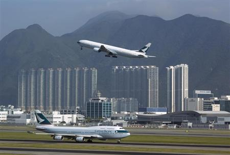 A Cathay Pacific Airways passenger plane takes off at the Hong Kong Airport September 11, 2013. REUTERS/Tyrone Siu