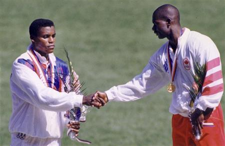 Ben Johnson of Canada (R), wearing his gold medal, shakes hands with silver medalist Carl Lewis of the U.S. after winning the men's 100 meters sprint final at the Olympics in Seoul September 24, 1988. REUTERS/Gary Hershorn