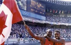 Ben Johnson of Canada (L) celebrates with team mate Desai Williams after winning the men's 100 meters sprint final at the Olympics in Seoul September 24, 1988. REUTERS/Pool
