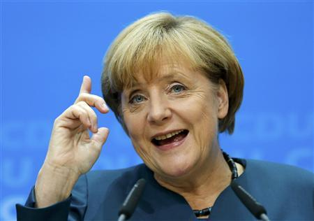 German Chancellor and leader of the Christian Democratic Union ( CDU) Angela Merkel, gestures during a news conference after a CDU party board meeting in Berlin September 23, 2013, the day after the general election. REUTERS/Fabrizio Bensch