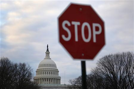 A traffic sign is seen near the U.S. Capitol building in Washington March 1, 2013. REUTERS/Jonathan Ernst
