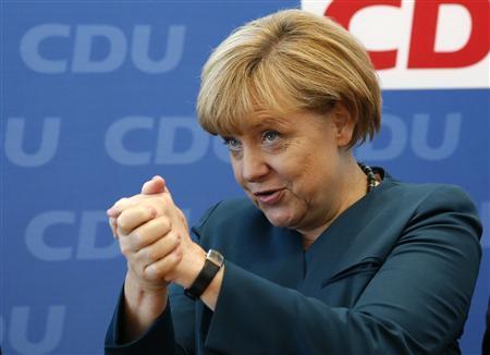 Triumphant Merkel starts tough task of seeking coalition