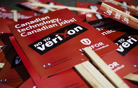 A pile of signs is pictured after a rally held by the Unifor union to protest against the possible entry of U.S. telecommunications firm Verizon into the Canadian wireless market in Toronto, in this August 30, 2013 file photo. REUTERS/Mark Blinch