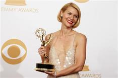 """Actress Claire Danes from Showtime's series """"Homeland"""" poses backstage with her award for Outstanding Lead Actress In A Drama Series at the 65th Primetime Emmy Awards in Los Angeles September 22, 2013. REUTERS/Lucy Nicholson"""