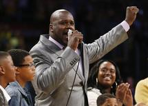 Former Los Angeles Lakers' Shaquille O'Neal gestures as he speaks during a ceremony to retire jersey #34 in honor of O'Neal during halftime of the NBA basketball game against the Dallas Mavericks in Los Angeles, April 2, 2013. REUTERS/Danny Moloshok