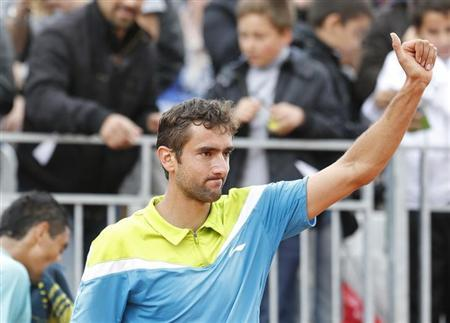 Marin Cilic of Croatia celebrates defeating Nick Kyrgios of Australia in their men's singles match during the French Open tennis tournament at the Roland Garros stadium in Paris May 29, 2013. REUTERS/Vincent Kessler/Files