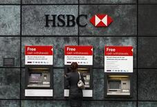 A woman uses an ATM at a HSBC bank in the City of London February 28, 2011. REUTERS/Andrew Winning