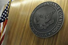 The seal of the U.S. Securities and Exchange Commission (SEC) hangs on the wall at their headquarters in Washington, in this June 24, 2011 file photo. REUTERS/Jonathan Ernst/Files