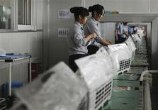 Employees make air-conditioners along a production line at a factory of Gree Electric Appliances in Hefei, Anhui province August 6, 2011. REUTERS/Stringer