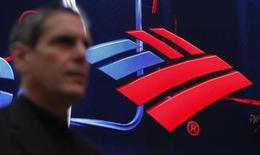 A man walks next to a Bank of America's branch in New York October 24, 2012. REUTERS/Eduardo Munoz