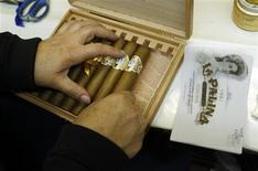Niurka Perez packs a box of cigars at the El Titan de Bronze cigar factory and store in the Little Havana neighborhood of Miami, Florida September 18, 2013. REUTERS/Joe Skipper