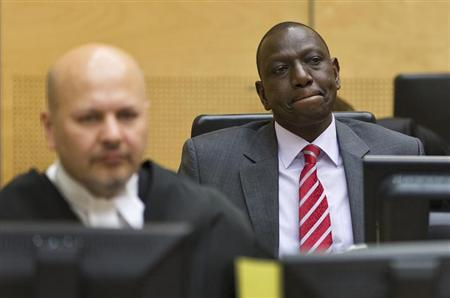 Kenya's Deputy President William Ruto (R) reacts as he sits in the courtroom before his trial at the International Criminal Court (ICC) in The Hague September 10, 2013. REUTERS/Michael Kooren