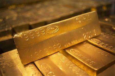 24 karat gold bars are seen at the United States West Point Mint facility in West Point, New York in this June 5, 2013 file photo. REUTERS/Shannon Stapleton/Files