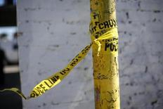 A police line tape is seen at the site of the fatal stabbing of a Los Angeles Dodgers fan after he attended a baseball game in San Francisco, California September 26, 2013. REUTERS/Stephen Lam