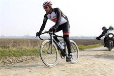 Radioshack rider Fabian Cancellara of Switzerland cycles on a cobble-stoned section of the Paris-Roubaix cycling race during training in Haveluy near Valenciennes April 4, 2013. REUTERS/Pascal Rossignol