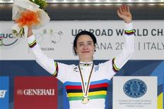 Marianne Vos of the Netherlands celebrates on the podium after winning the gold medal in the women's elite road race at the UCI Road World Championships in Florence September 28, 2013. REUTERS/Giampiero Sposito
