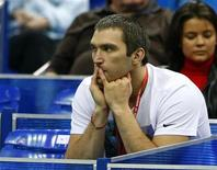 Russian hockey player Alexander Ovechkin watches the match between Russia's Maria Kirilenko and Sweden's Sofia Arvidsson during their Kremlin Cup tennis match in Moscow October 19, 2012. REUTERS/Grigory Dukor
