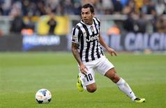 Carlos Tevez, jogador do time italiano Juventus em partida contra o Torino, pelo Campeonato Italiano, em Turim, Itália. 29/09/2013 REUTERS/Giorgio Perottino