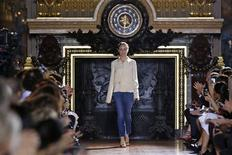 British designer Stella McCartney appears at the end of her Spring/Summer 2014 women's ready-to-wear fashion show during Paris fashion week September 30, 2013. REUTERS/Benoit Tessier