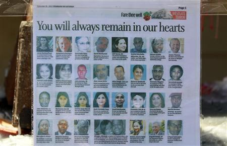 A newspaper cutting shows pictures of the slain victims who were killed in the recent Westgate shopping mall attack in Kenya's capital Nairobi, September 30, 2013. REUTERS/Thomas Mukoya