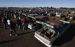Potential buyers and car enthusiasts check out vintage automobiles from the Lambrecht Collection, before they are put up for auction in Pierce, Nebraska September 28, 2013. REUTERS/Jim Urquhart
