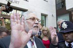 Former Radio 1 DJ, Dave Lee Travis, real name David Patrick Griffin, leaves after appearing at Westminster magistrates' court in London August 23, 2013. REUTERS/Neil Hall